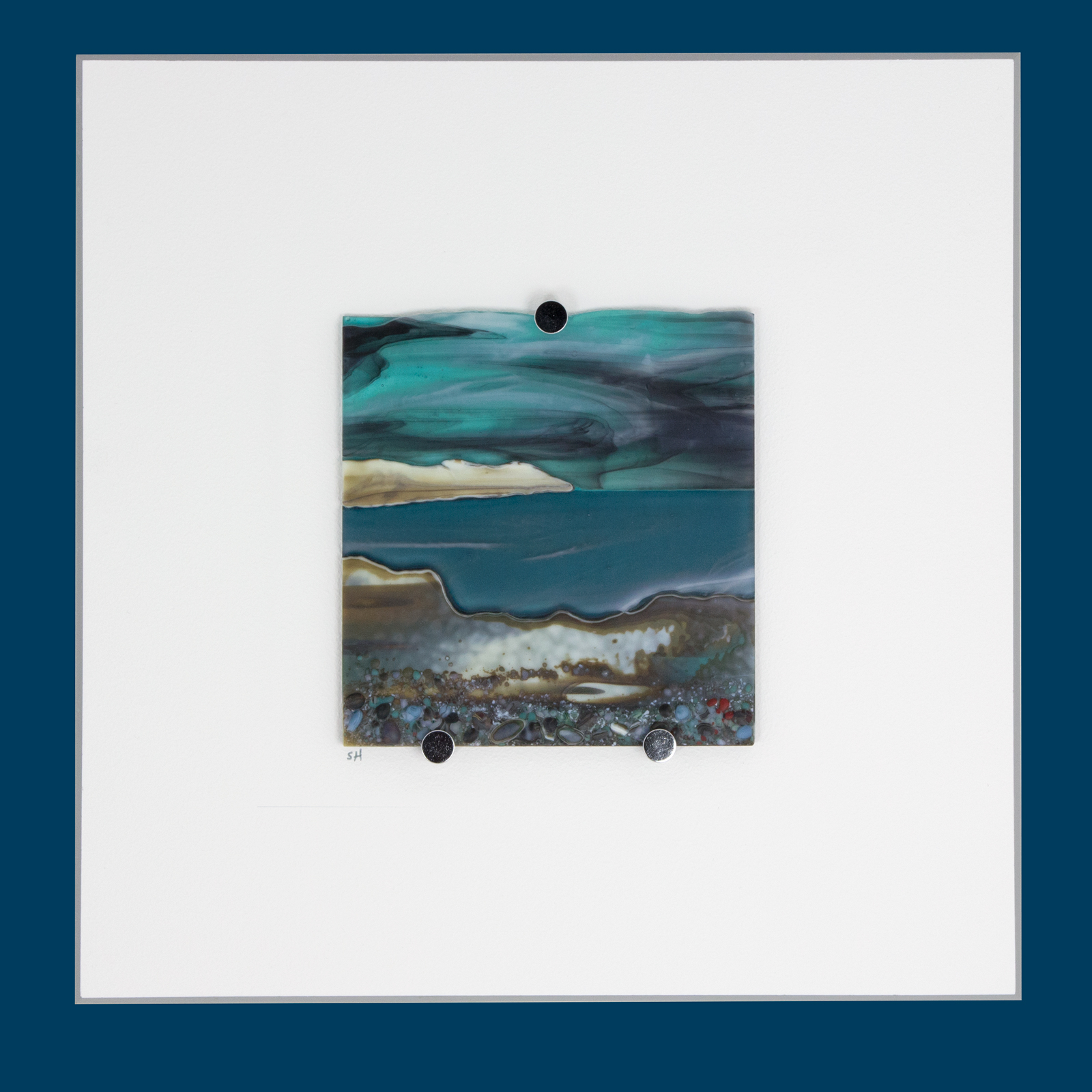 Glass Wall Art, welsh seascape. Aquamarine sky with moody clouds. Steel blue sea. Headland, foreground with french vanilla/browns/teals glass frits to fore. Mounted.