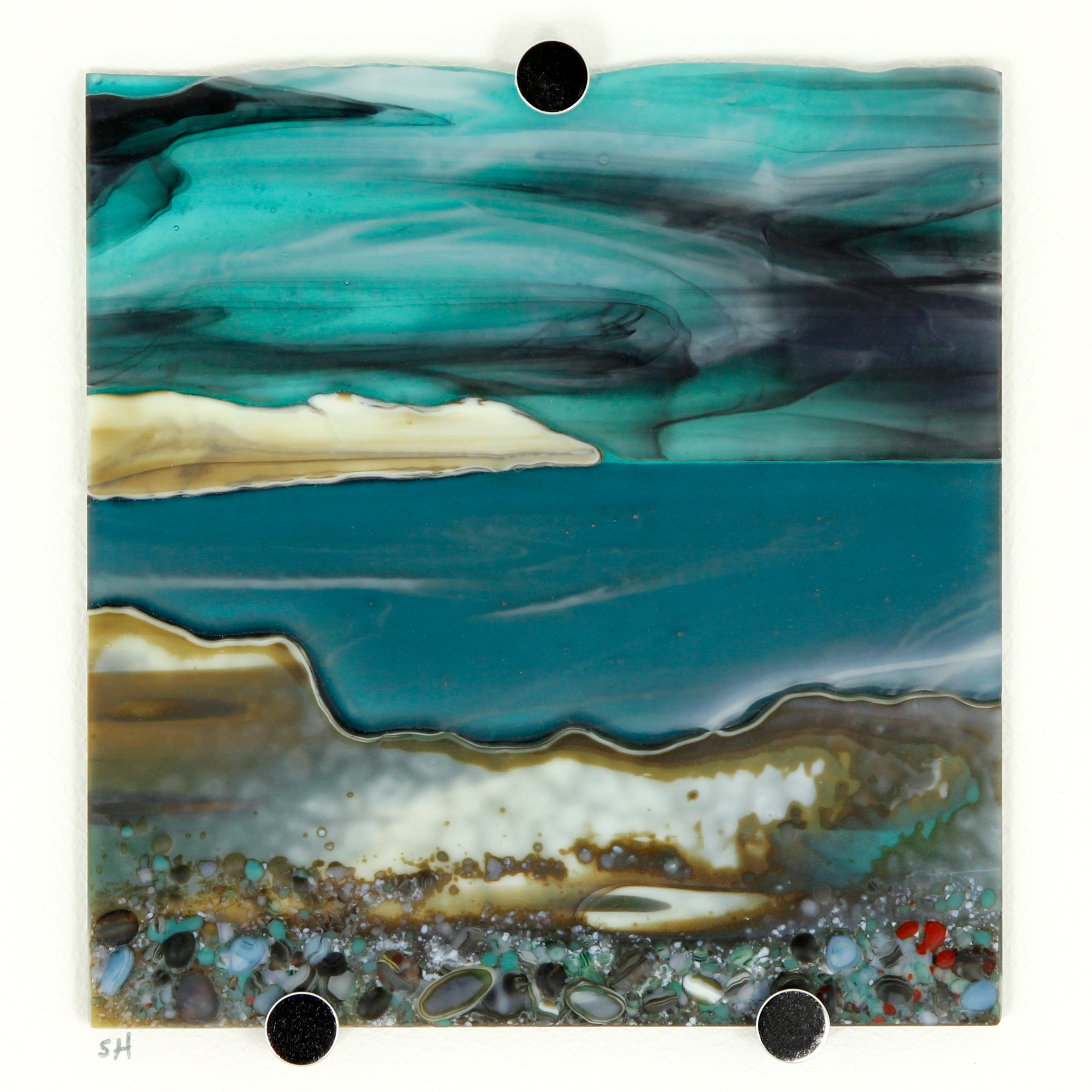 Glass Wall Art, welsh seascape. Aquamarine sky with moody clouds. Steel blue sea. Headland, foreground with french vanilla/browns/teals glass frits to fore.