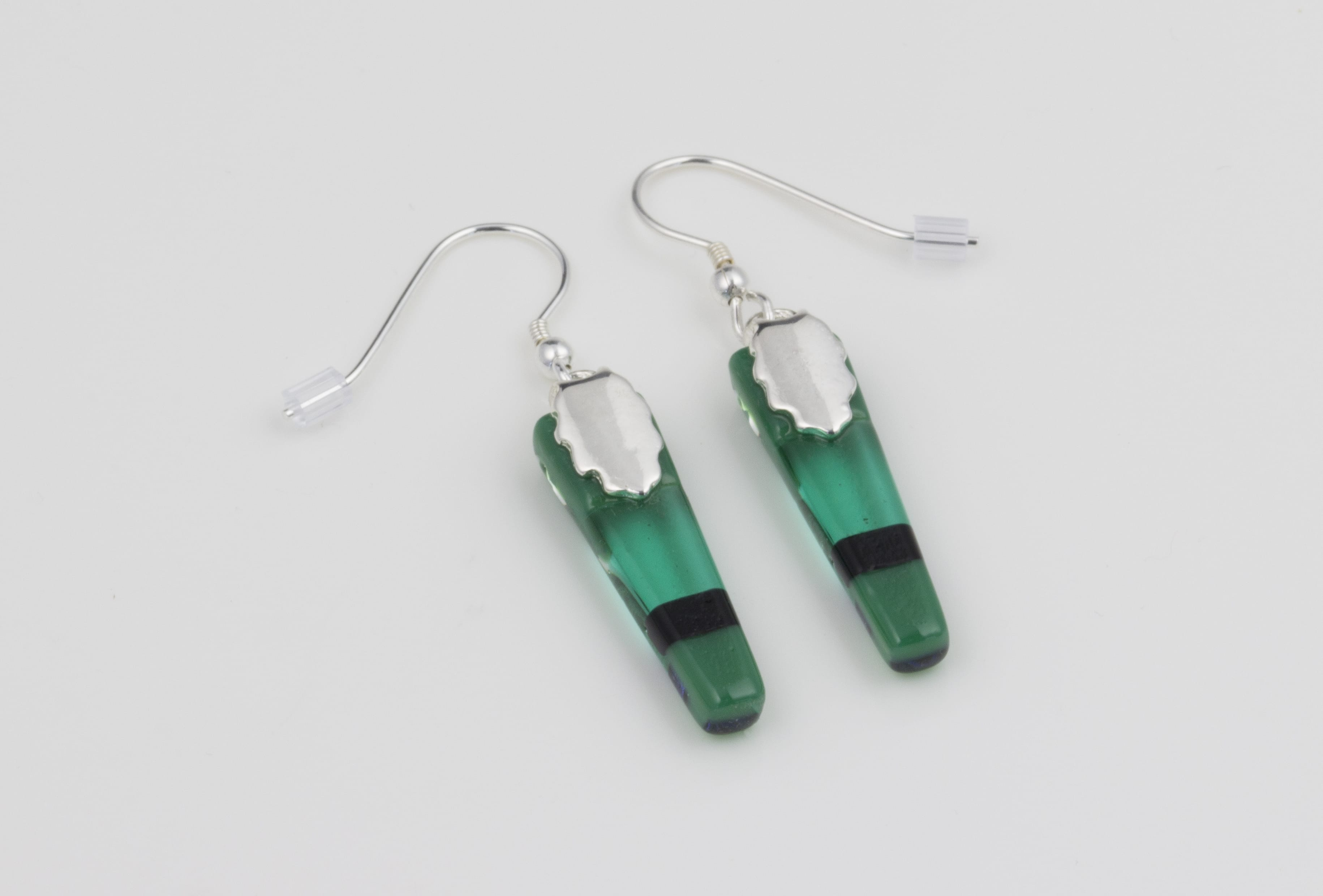 Dichroic glass jewellery, glass drop earrings, tapered green earrings with transparent, opaque and dichroic glass, art glass earrings handmade in Shropshire, sterling silver hooks