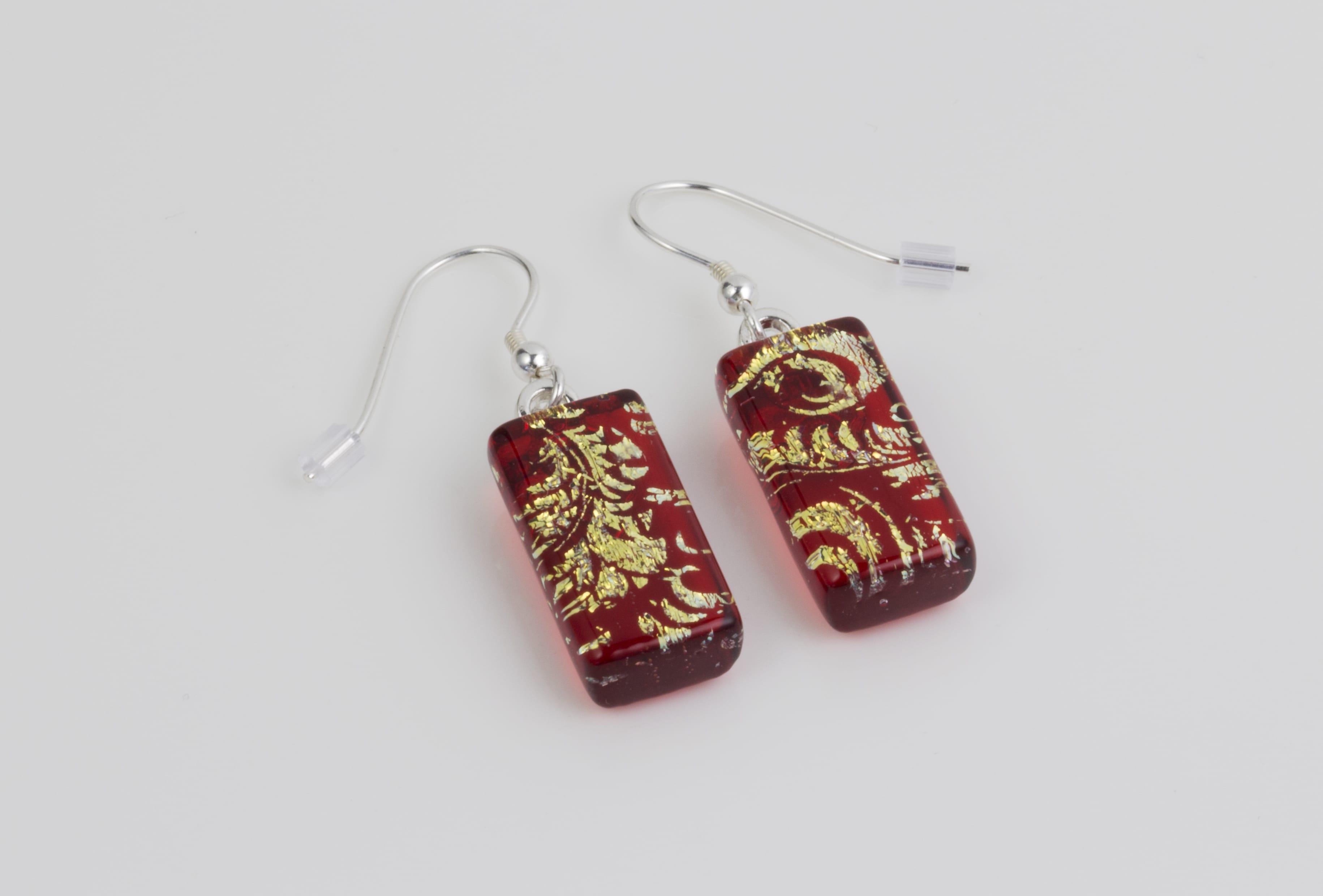 Dichroic glass jewellery uk, glass drop earrings, red earrings with gold plume pattern dichroic glass, art glass earrings handmade in Shropshire, sterling silver hooks