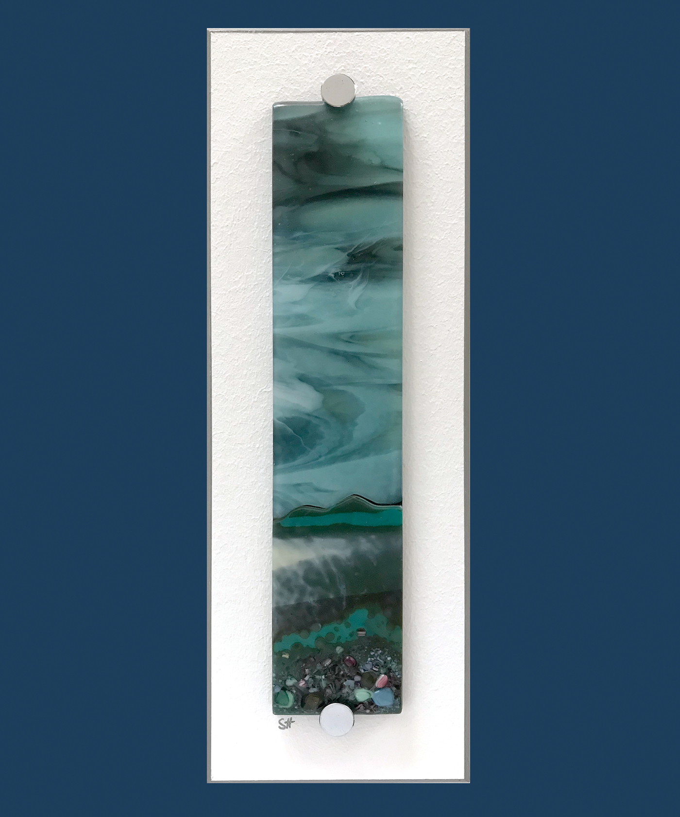 Winter Landscapes fused glass wall art – greens/browns/vanilla and pink/blue specks in fore, moody light aqua sky. Satin finish.