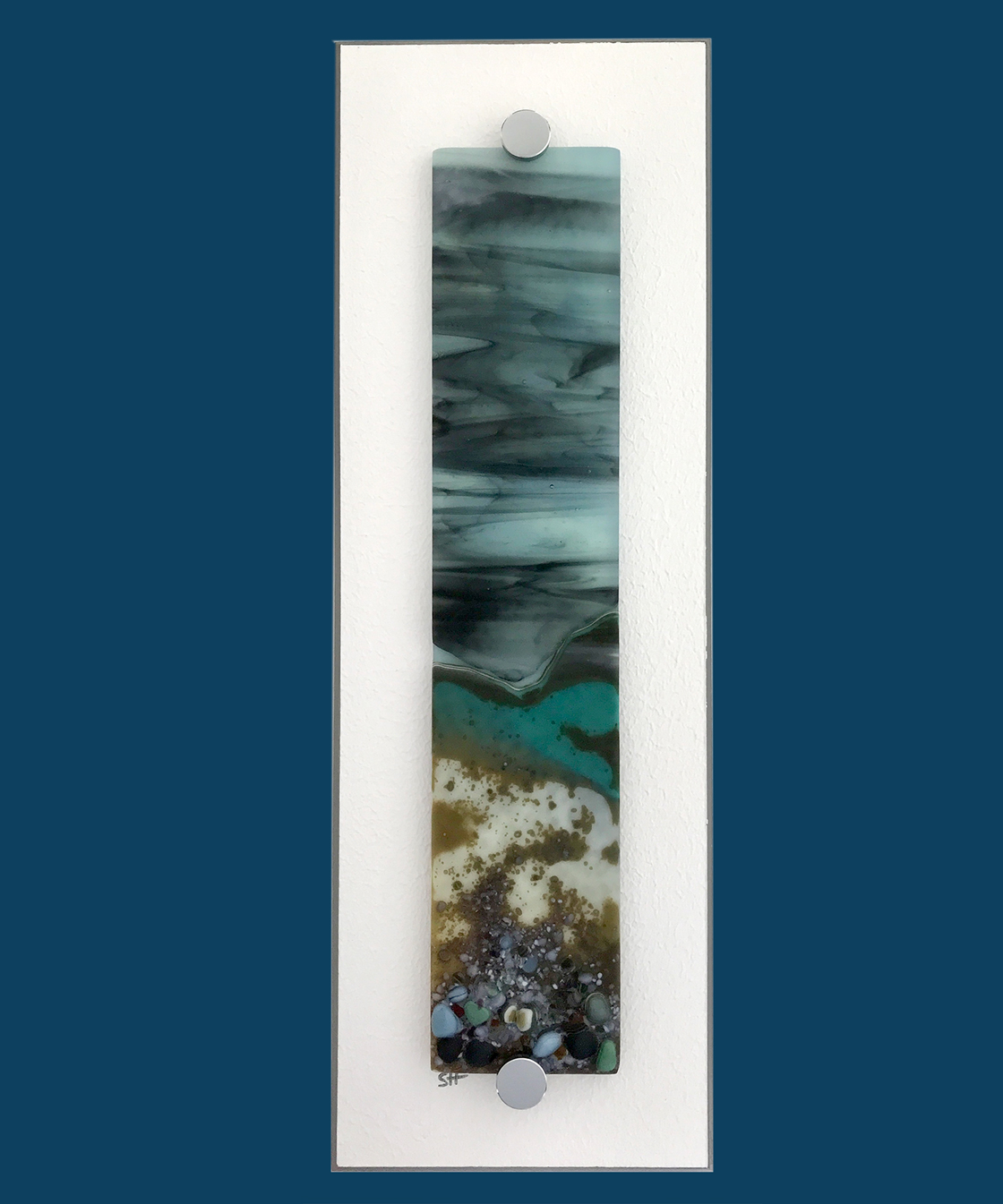 Winter Landscapes fused glass wall art – green/browns/vanilla to fore, green/greys specks, powder blue/grey sky. Satin finish.