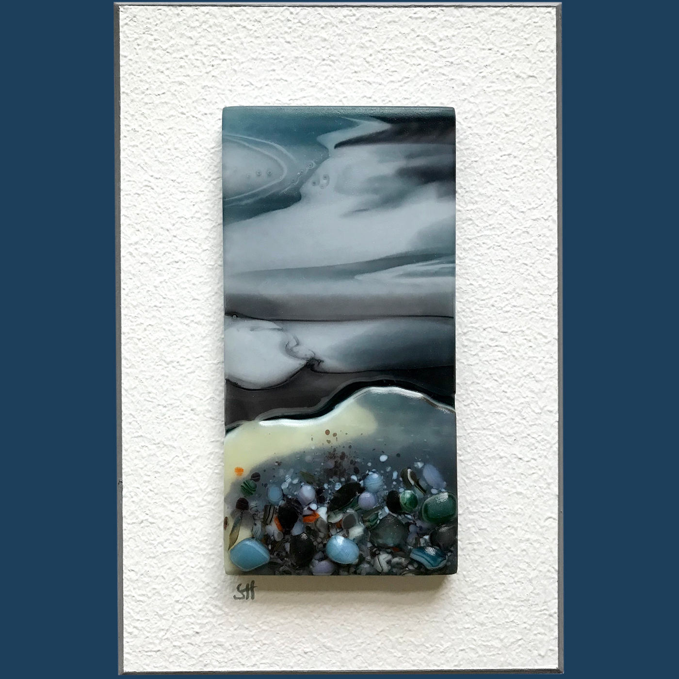 Seascapes fused glass wall art, coastal landscapes, dark sky clouds art, vanilla/grey/green/blues and glass frits in foreground.
