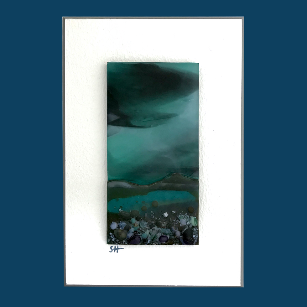 Seascapes fused glass wall art - moody sky, greens/brown lilac specks in landscape.