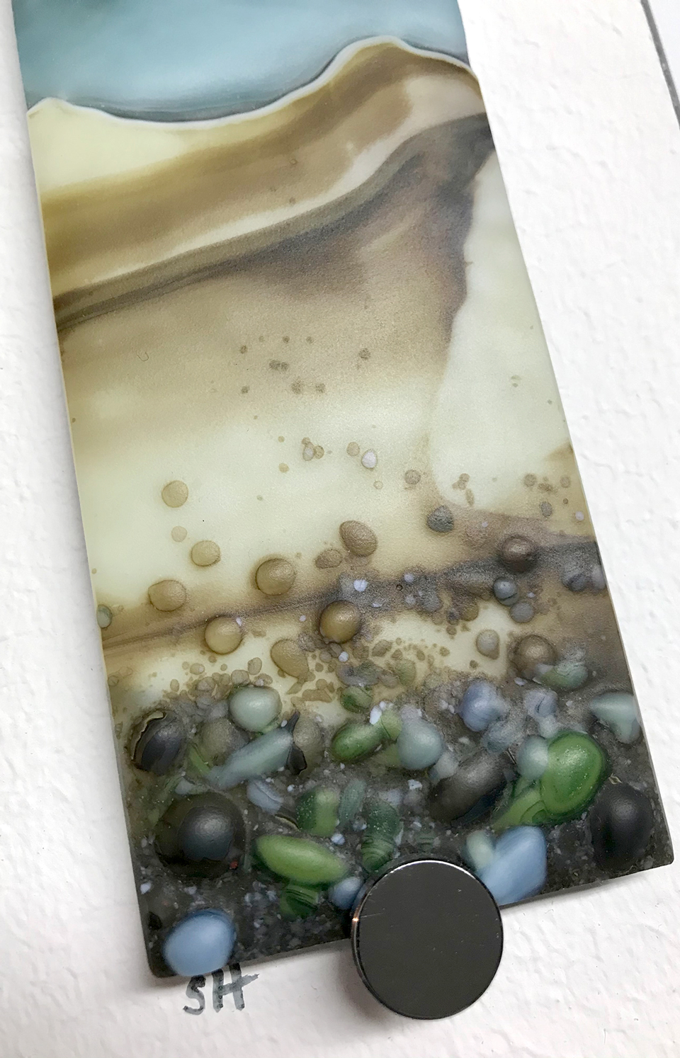 Winter Landscapes fused glass wall art – browns/vanilla to fore, green/greys/brown specks, powder blue/grey sky. Satin finish.