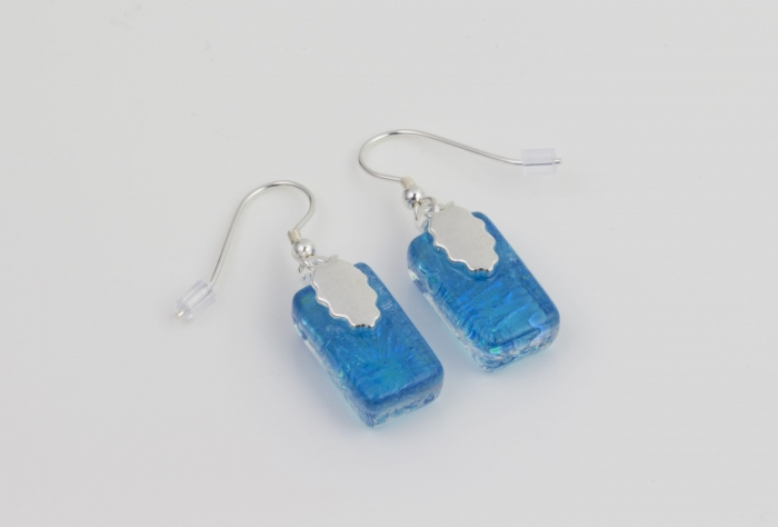 Dichroic glass jewellery, glass drop earrings, turquoise glass earrings with starburst pattern, art glass earrings, handmade in Shropshire, sterling silver hooks
