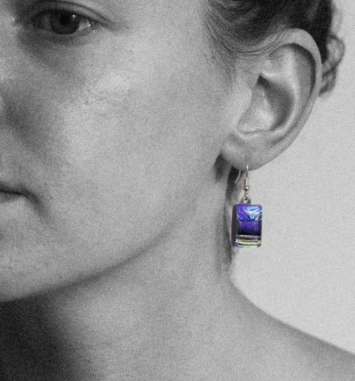 Dichroic glass jewellery, glass drop earrings, violet glass earrings with starburst pattern and lines, art glass earrings, handmade in Shropshire, sterling silver hooks