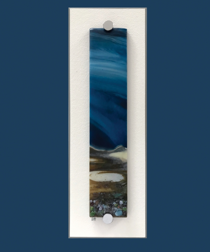 Winter Landscapes fused glass wall art– browns/vanilla foreground with green/lilac specks, swirling dark blue sky. Satin finish.