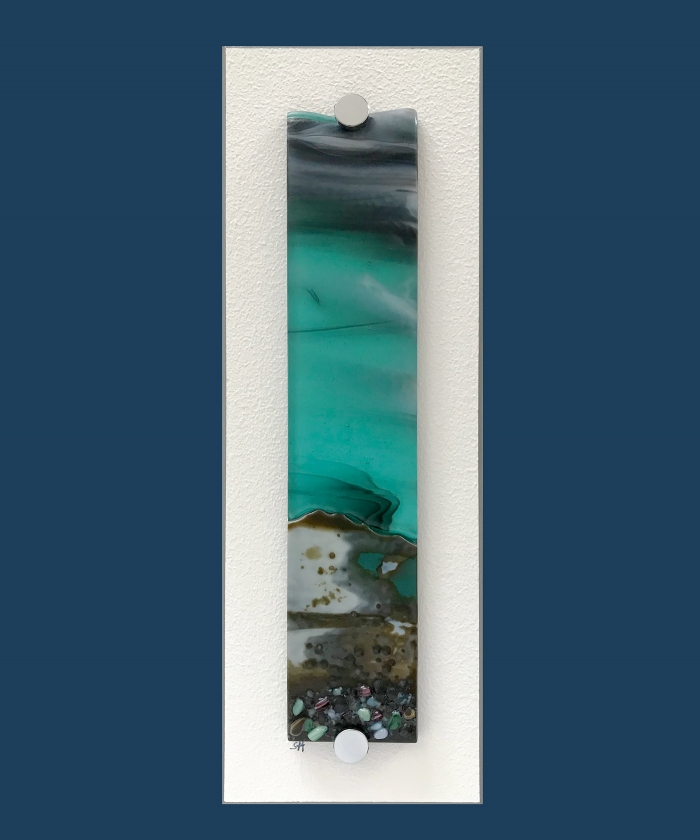 Winter Landscapes fused glass wall art – green/browns/vanilla to fore, green/claret specks, light aquamarine sky. Satin finish.